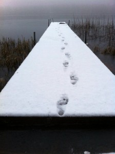 Footprints in snow on jetty